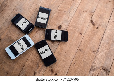 A circle of generic smartphones with #Metoo hashtag.