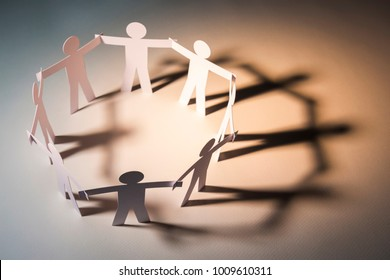 circle joining of paper figure on light background. in concept of business, cooperation and teamwork.