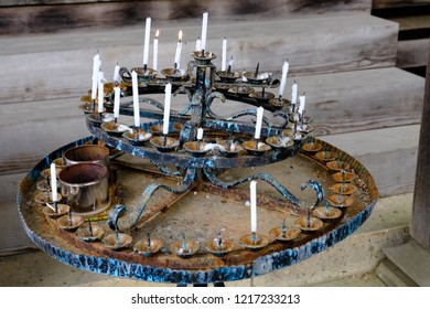 Circle old menorah Buddhist people lighting the candle pray to the buddha once they go to temple. White candles put surrounding in circle in menorah at a Buddhist shrine.
