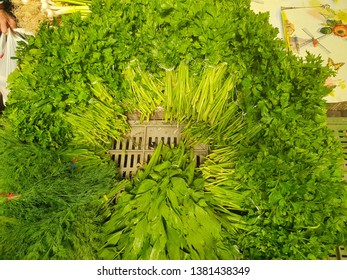 Circle of Organic Parsley and Lovage Herb in the Local Market Place, Green Fresh Flavored Harvested Leaves, Raw Italian Parsley