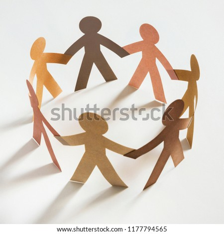 Circle of paper cutout figures, ethnic diversity