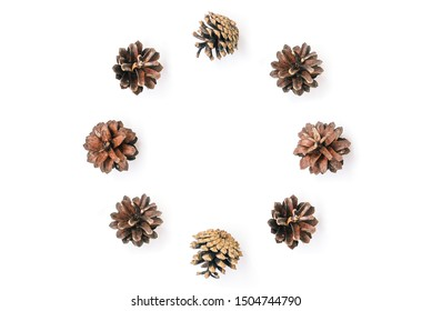 Circle of pine cones on a white background. Natural christmas composition. Holiday card. Flat lay. View from above