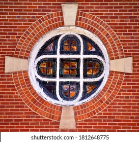 Circle shaped stained glass window on the Clarendon United Methodist Church, Clarendon, Arkansas, also has round brick design circling historic window.