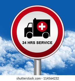 Circle Silver Metallic and Red Metallic Border Road Sign For Ambulance Car 24 HRS Service Against The Blue Sky Background