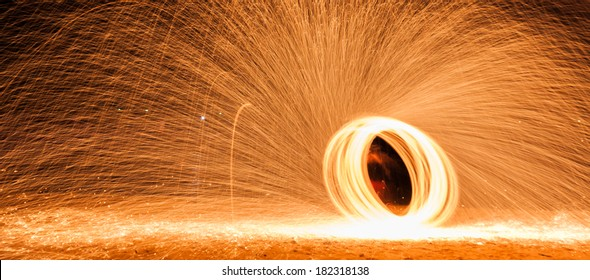Circle spark from man spin burning steelwool