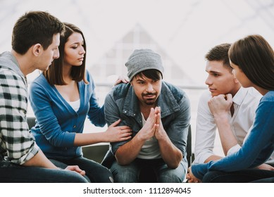 Circle of trust. Group of people sitting in circle and supporting each other.Support group.