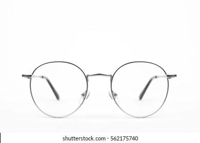 Circle vintage metal glasses on white background