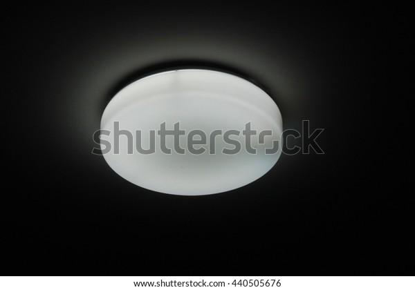 Circle of white fluorescent lamp on dark background