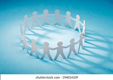 Circle of white paper cut-out figures