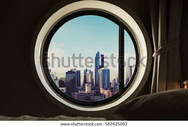 Circle windows with modern buildings in the city at morning