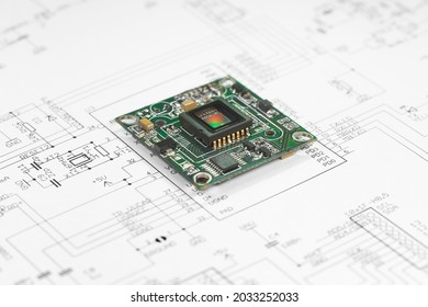The circuit board with the CMOS sensor lies on the circuit diagram