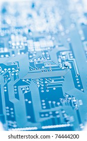 circuit board with shallow depth of field blue toned