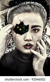 Circuit board showing through cracked and damaged face of cyborg child.  Illustration/photography.