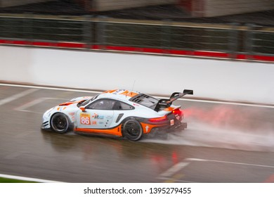 Circuit de Spa-Francorchamps, Belgium May 4 2019. Gulf racing Porsche heads to Eau Rouge in the rain. WEC Total 6 Hours of Spa.