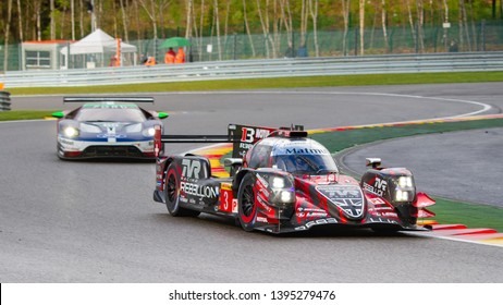 Circuit de Spa-Francorchamps, Belgium May 4 2019. Rebellion Racing LMP1 ahead of a Ford GT at Les Combes chicane. WEC Total 6 Hours of Spa. This car came 2nd overall.
