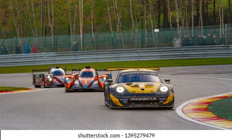 Circuit de Spa-Francorchamps, Belgium May 4 2019. Team Project 1 Porsche 911 ahead of LMP cars at Les Combes chicane. WEC Total 6 Hours of Spa.