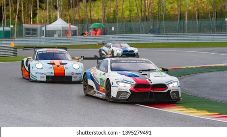 Circuit de Spa-Francorchamps, Belgium May 4 2019. MTEK BMW M8 ahead of Gulf Racing Porsche and another BMW M8 at Les Combes chicane. WEC Total 6 Hours of Spa.