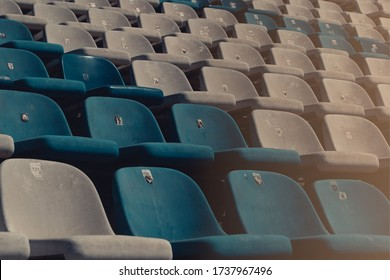 Circuit seats without spectators. Empty stadium without fans. Concept of sports show held behind closed doors. Consequences of the COVID-19 pandemic. Security measures in different sports.