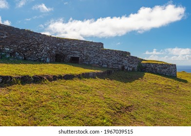 Circular ceremonial construction and religious center of Orongo by Rano Kau volcanic crater and Pacific Ocean on Rapa Nui, Easter Island, Chile. - Shutterstock ID 1967039515