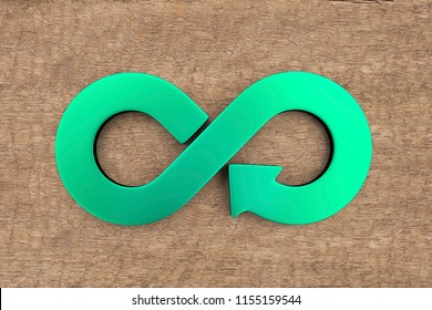 Circular economy concept. Green arrow infinity recycling symbol on wooden background.