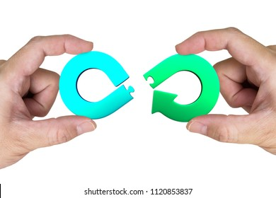 Circular economy concept. Two hands assembling arrow infinity recycling symbol of jigsaw puzzle pieces, isolated on white.
