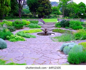 Circular Herb Garden with Fountain.  Dunedin Botanic Gardens, Dunedin, New Zealand.