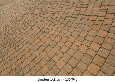 Circular pattern of brick paving stones