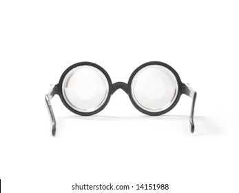 Circular prescription glasses isolated on white.