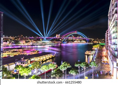 Circular Quay and Sydney Harbour Bridge illuminated with colorful light, during the Vivid Sydney 2017