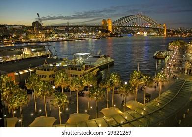 Circular Quay in Sydney, night photo, harbour bridge in background