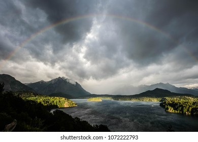 Circular rainbow arc over Chico lake in Bariloche,Argentina