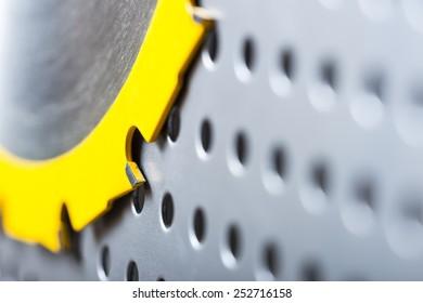 Circular saw blade on a pegboard.