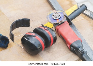 circular saw with broken disc on wooden table