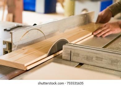 Circular saw cuts wood close up