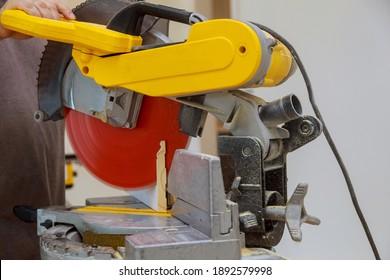 Circular saw cutting sharp rotary blade new baseboard woodwork equipment machinery