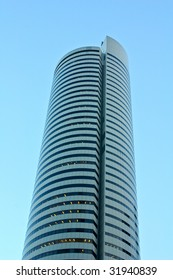 A circular shaped building under the blue sky