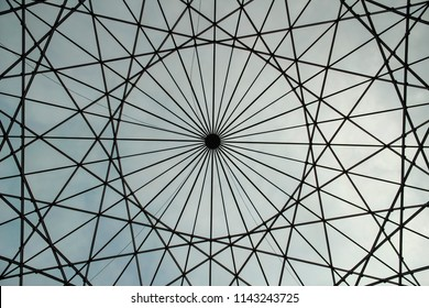 Circular shaped metallic structure with a sky background