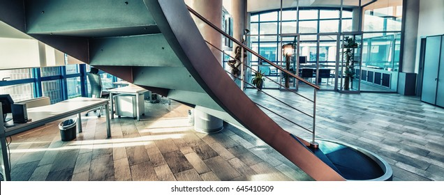Circular stairs on modern office interior.
