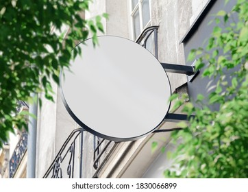 Circular store brand sign board mockup. Empty rounded shop frontage in street