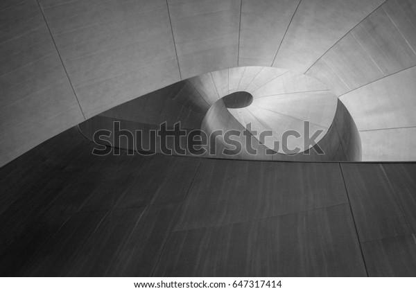 circular swirling wood grain paneling as background texture