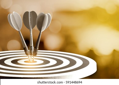 Circular target marked with numbers and dart with defocused or blurred bokeh background. An idea of business targets, audience, market, group, analysis, risk, rate, area, value