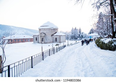 "Circular temple winter season, Nukha snow on three holy chapels. The name of the church until 1905 from a single source ""Nukha Holy Church"" as passed. Sheki, Azerbaijan - December 16, 2017"