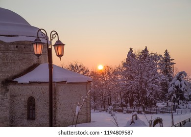 "Circular temple winter season snow on the three holy chapels at sunset, Nukha. The name of the church until 1905 from a single source ""Nukha Holy Church"" as passed. Sheki, Azerbaijan.17 December 2017"