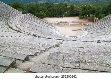 Circular tribunes high above the stage of ancient amphitheater located in Epidaurus, Greece