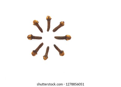 Circularly lined up dry cloves isolated on white background.
