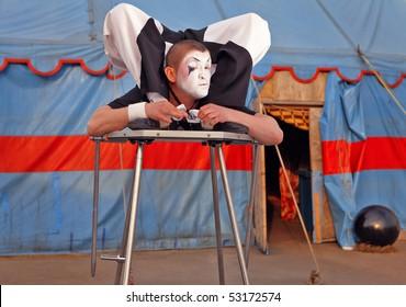 Circus acrobat with a plastic body executes his  tricks. Photo.