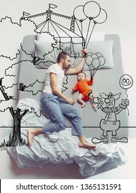 Circus brings bright emotions. Top view photo of young man and his child sleeping in a big white bed. Dreams concept. Painted dream about family weekend, entertainment, balloon, clown, walk.