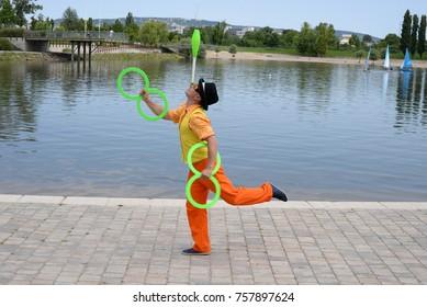 Circus juggler portrait. Clown juggling with balls.