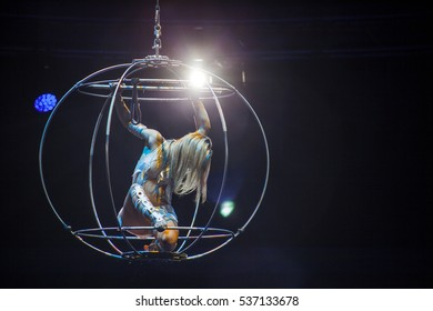 Circus. Sphere. Aerial gymnast in sphere. Circus artist. Flying under the big top. The risk to life. Without insurance.