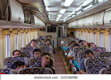 "Cirebon, Indonesia - 4 February 2015: Inside a passenger coach of the Diesel Train CC 2061331""DIPO INDUK YK"" on its way from Jakarta to Yogyakarta"